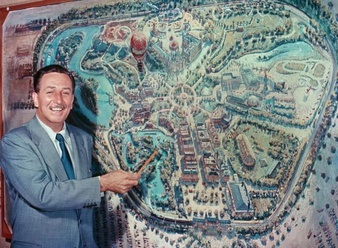 Walt Disney in front of early rendering Disneyland